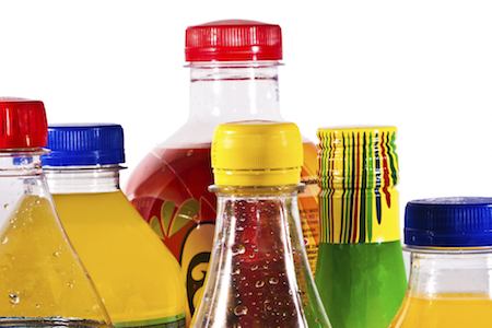 packs of soda bottles in closeup over white background