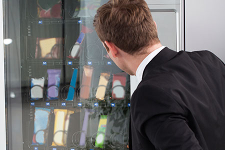Man Choosing a Snack from the Vending Machines