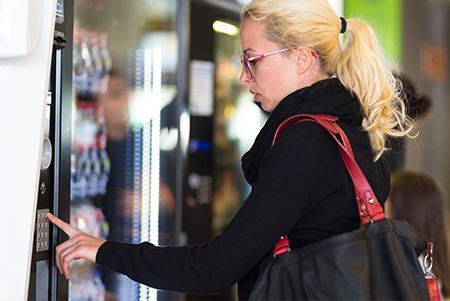 Woman at a Micro Market Vending Machine