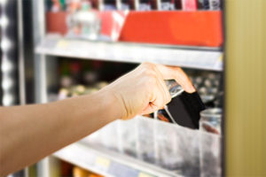 A-hand-is-getting-a-drink-from-micro-market-vending-machine