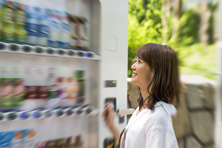 Woman-looking-at-choices-at-vending-machine