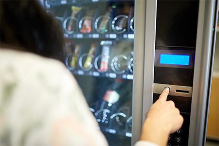 woman-choosing-something-from-vending-machine