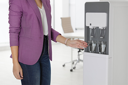 woman-getting-filtered-water-from-machine